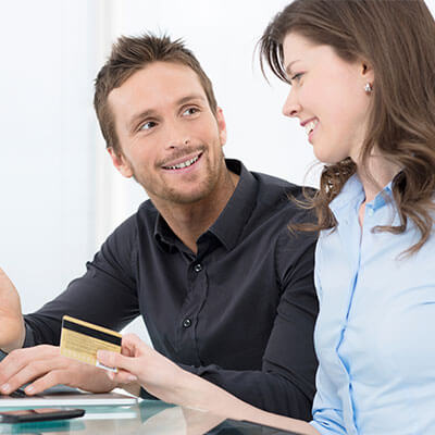 A couple paying for the dentist online with a credit card