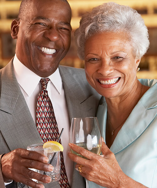A mature couple toasting their glasses