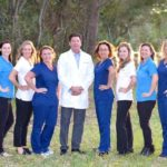 Dr. Field and staff smiling together